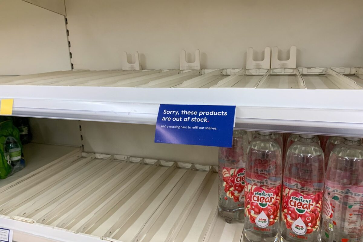 empty bottled  drink shelves in Tesco on Monday morning. Costa Coffee and supermarkets in Cambridgeshire were experiencing shortages this morning (Mon) due to supply chain issues and a lack of lorry drivers.Many shelves in Tesco and Sainsbury's stores in Ely were bare as Covid and Brexit have combined to create a hold up in deliveries.Toilet roll and water were among the items in short supply, with a critical shortage of lorry drivers being blamed.Meat shelves were also emptier than usual, with experts warning British meat could run out in two weeks after soaring energy prices led to a drop off in CO2 supplies, impacting the meat industry's ability to slaughter animals humanely. Empty supermarket shelves, Cambridge, UK - 20 Sep 2021,Image: 633757902, License: Rights-managed, Restrictions: , Model Release: no, Credit line: Profimedia