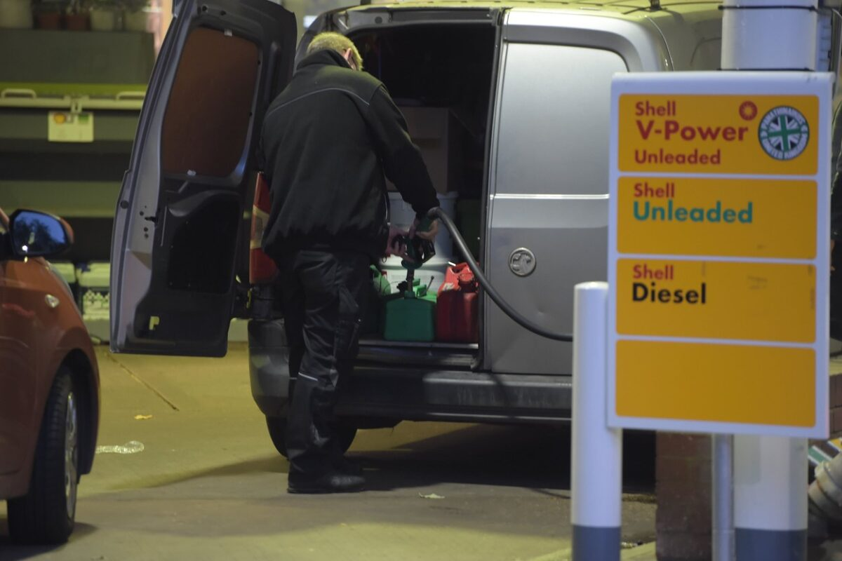 Large queues at petrol stations today as a man fills up a van full of Jerry Cans. Bayswater Road London. Britain has been gripped by a rush of panic buying that has left petrol stations dry across major cities. Oil companies have warned that they do not have enough tanker drivers to move petrol and diesel from refineries to filling stations.,Image: 635409629, License: Rights-managed, Restrictions: WORLDWIDE RIGHTS AVAILABLE. End users shall not licence, sell, transmit, or otherwise distribute any photographs represented by eyevine, to any third party., Model Release: no, Credit line: Profimedia